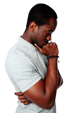 Side view portrait of a pensive african man over white background photo