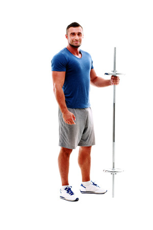 Full length portrait of a happy sportsman standing with barbell