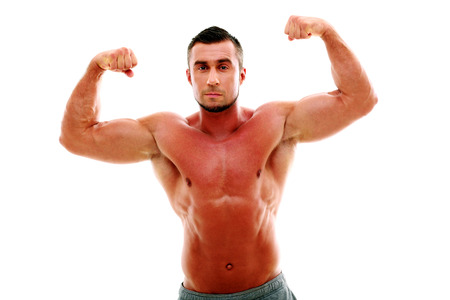 Serious muscular man showing his biceps isolated on white background photo