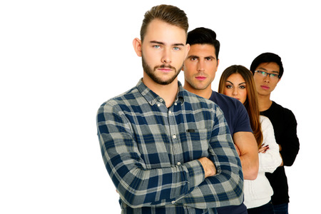 crossed arms: Serious students with arms folded standing over white background