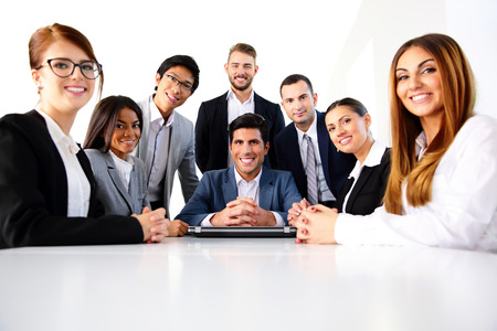 Group of a smiling colleagues in office photo