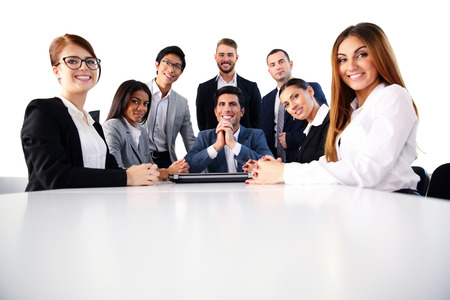 Group of a happy businesspeople on the meeting photo