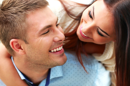Closeup portrait of a smiling couple Stock Photo