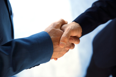 Handshake business: Closeup of a business handshake Stock Photo