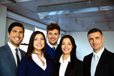 modern business lady: Group of a happy business people standing together in office