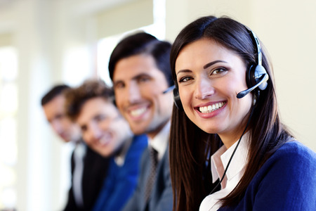 environments: Cheerful young businesspeople and colleagues in a call center office