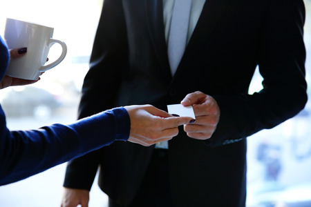 Concept shot of exchange business card between man and woman 스톡 콘텐츠