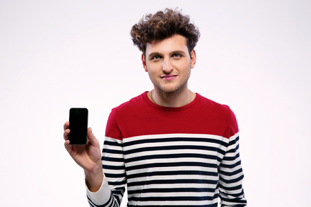 Handsome man showing a blank smartphone display Stock Photo