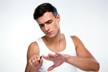 concetrated: Man doing manicure over gray background