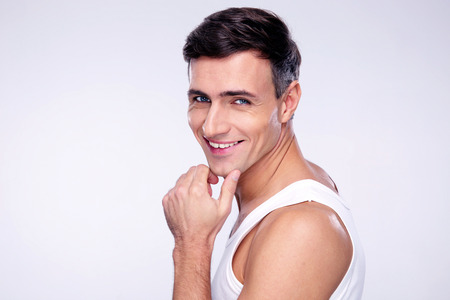 Portrait of a cheerful young man over gray background Stock Photo