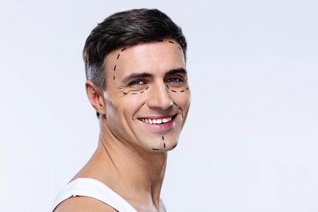 Glücklicher Mann mit Linien für Plastische Chirurgie markiert Standard-Bild - 35151791
