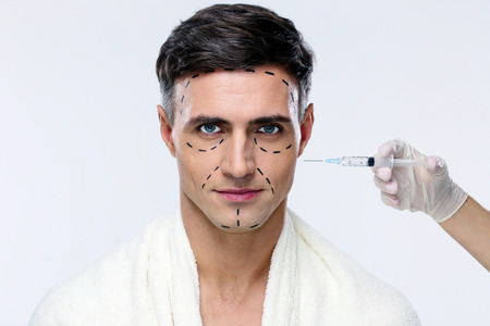 reg: Man at plastic surgery with syringe in his face
