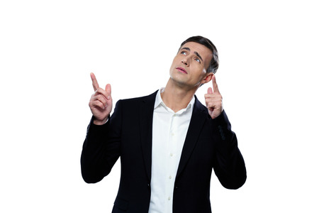 Pensive businessman pointing up with his finger photo