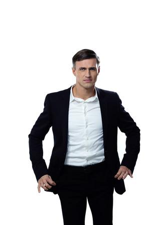Portrait of a businessman showing his empty pockets photo