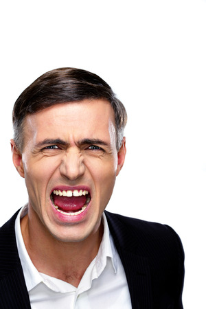 Portrait of a businessman yelling over white background Stock Photo