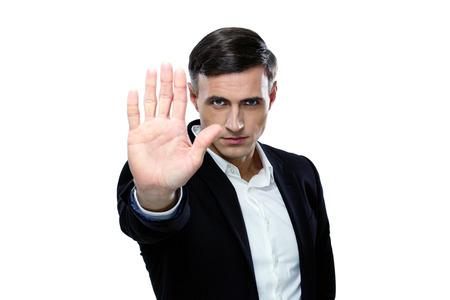 Confident buisnessman making stop gesture