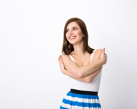 skepticism: Portrait of a happy thoughtful woman looking up at copyspace Stock Photo