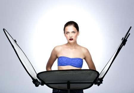 Young beautiful model posing at studio photo