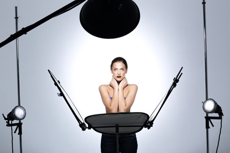 professionally: Young model posing in professionally equipped studio