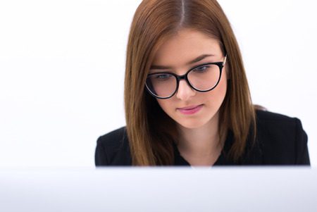 concetrated: Young beautiful business woman working on PC Stock Photo