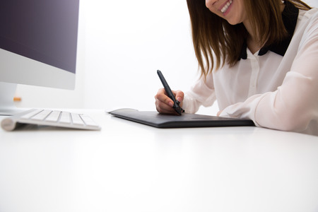 peripherals: Closeup image  of female hands working on graphic tablet Stock Photo