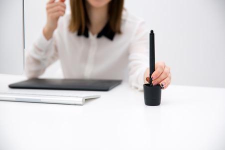 digitized: Closeup portrait of female hand holding tablet pen