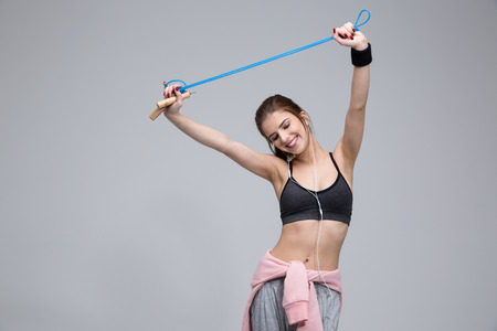 girl  care: sport, exercise and healthcare - sporty woman with skipping rope