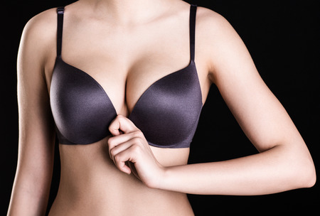 breasts erotic: Closeup image of a beautiful womans breasts in bra