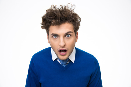 Surprised young man looking at the camera over white background Stock Photo