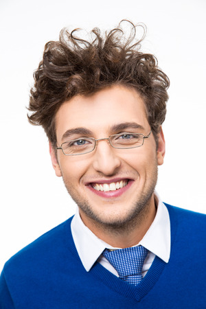 Cheerful business man with curly hair and glasses over white background photo