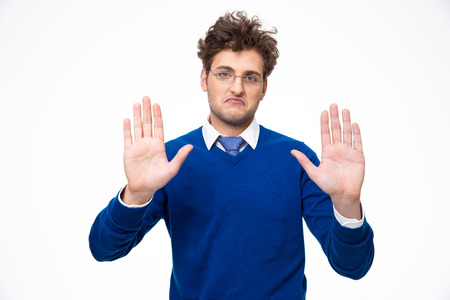 restrain: Handsome man showing stop gesture over white background