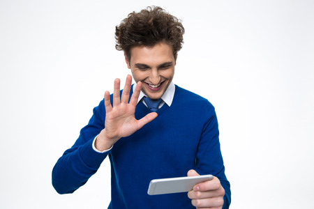 Happy business man using smartphone over white background photo