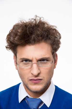 aggravated: Angry young businessman in glasses looking at camera Stock Photo