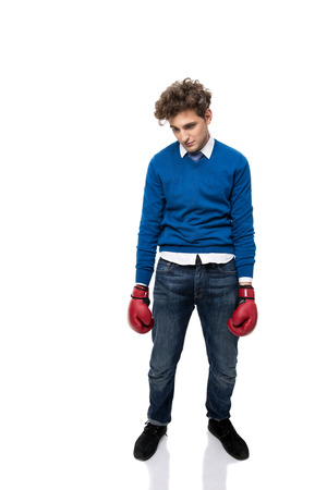 defeated: Full length portrait of a defeated young business man over white background
