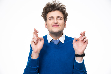 falsehood: Young man with crossed fingers over white background