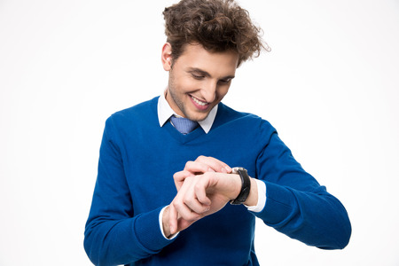 looking at watch: Happy businessman looking at watch over white background