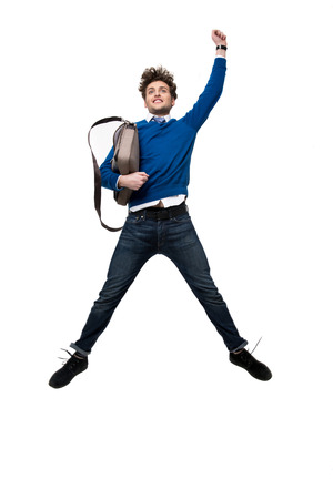 vertica: Happy business man jumping with bag over white background