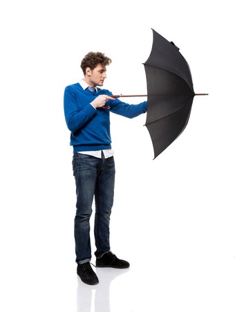 Full length portrait of a man standing with umbrella photo