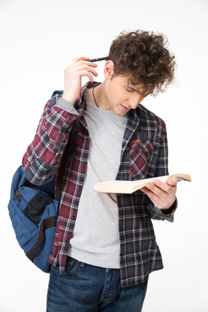 Male student reading book over gray background photo