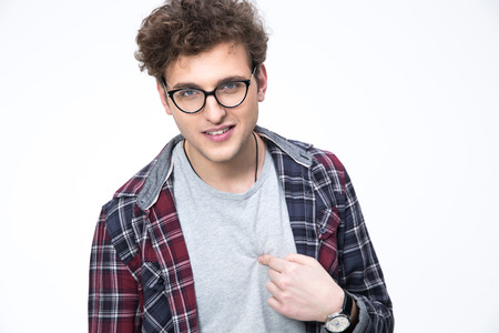 hesitating: Young man in glasses pointing at himself