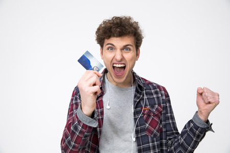 Casual man standing with credit card and shouting