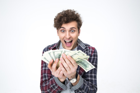 fanned: Portrait of a cheerful young man holding bills of dollars
