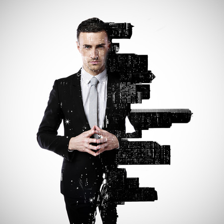 Double exposure of a city and professional businessman standing on a gray background Stok Fotoğraf