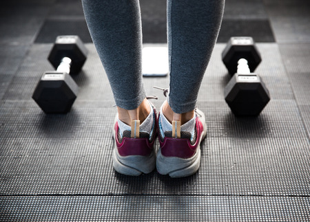 image: Closeup image of a female legs at gym Stock Photo