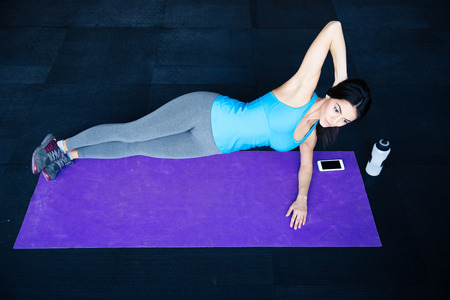concetrated: Beautiful fit woman working out on yoga mat at gym Stock Photo