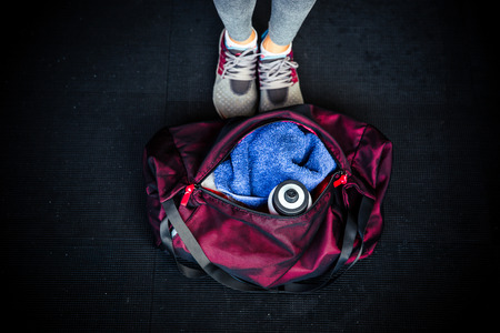 gym equipment: Closeup image of fitness bag with female legs