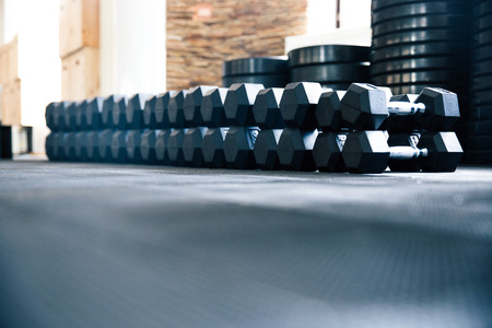weight weightlifting: Closeup image of a fitness gym with dumbbells
