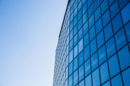 Closeup image of a glass business building