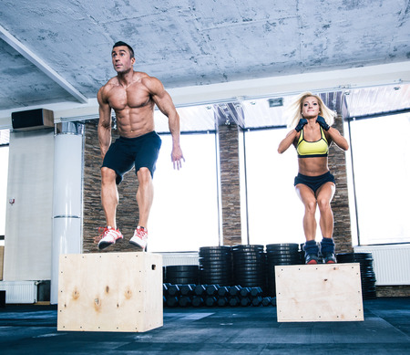 fitness equipment: Group of man and woman working out with fit box at gym