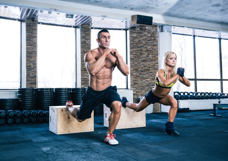 fitness girl: Woman and man working out with fit box at gym